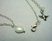 Abigail - irridescent white heart swooping bird necklace