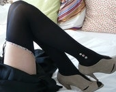 "Stockings with Liberty garter and ""ankle-boot like"" buttons"