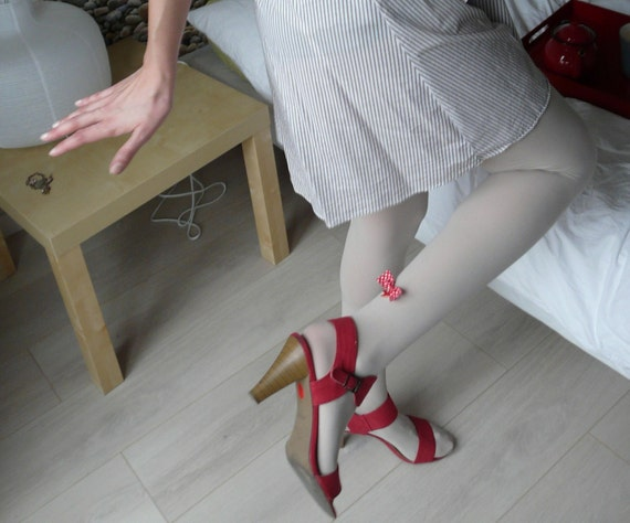 Beige stockings with red and white polkadots Liberty garter, and red swallow and bow ornament
