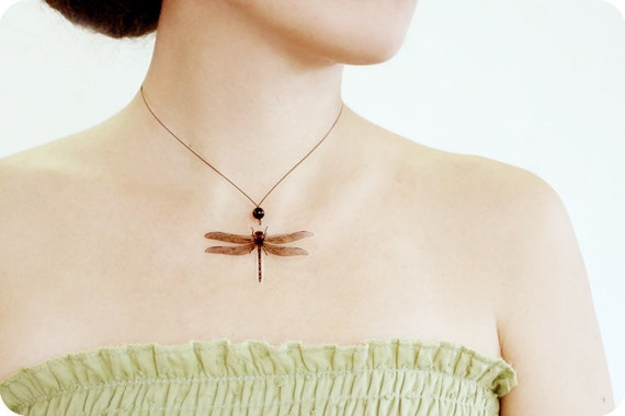 Dragonfly transparent necklace on the black wire with the black onyx beed