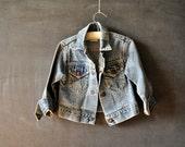 Retro Levi's denim jean jacket, light wash, snap up, size 4t