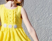 Spring yellow dress with black and white buttons