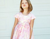 Pink dotted dress with button accent