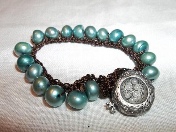 Gorgeous Hand Beaded Semi Precious freshwater Pearl Bracelet..Birds Nest Charm Too