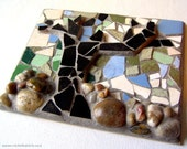 Abstract tree design, mosaic art, ceramic tiles and pebbles/rocks, grouted to tile