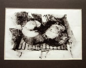 Two black kettles on a stove, monoprint