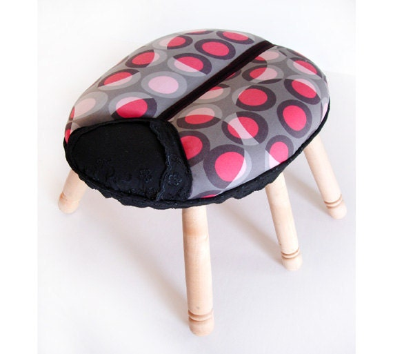 Ladybird stool - childrens seat with 6 legs, sculpted spotty cushion padding.