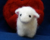 Little Lamb with a Heart. Needle-felted wool baby animal with red wool heart-shaped pocket.