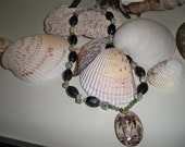 Cowie shell focal necklace with natural stone beads.