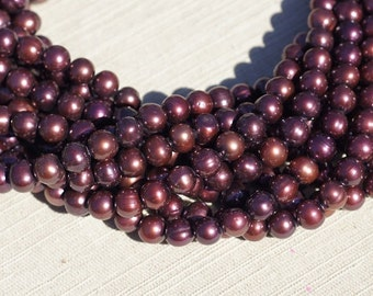Luxe AA Freshwater pearl red, Burgundy Red. Round 7.5 mm, pack  of  strand 16 inches  Birthday July