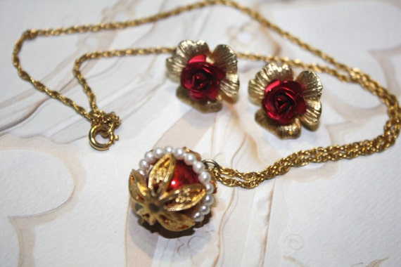 Vintage Jewelry Lot, Gold Type Post Earrings featuring Red Metal Roses, and Decorated Pendant on Necklace.