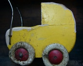 Little yellow wooden baby carriage