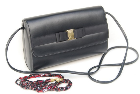 Sale Vintage Mad Men evening black purse with bow gold metal clasp closure 1950s.