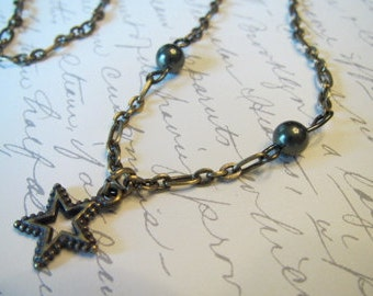 Antique Star with dark green pearls