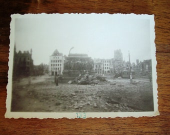 CAUTION ADULT Content - WWII Photos - Aerial Bombing, Toppled Monument, Soldier Bodies & More