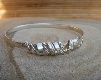 Silver bangle with silver rings