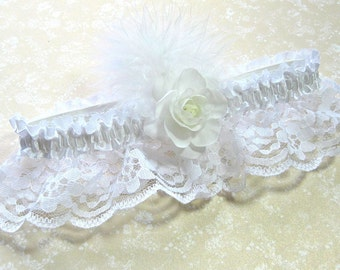 White bridal garter with flower and feather trim