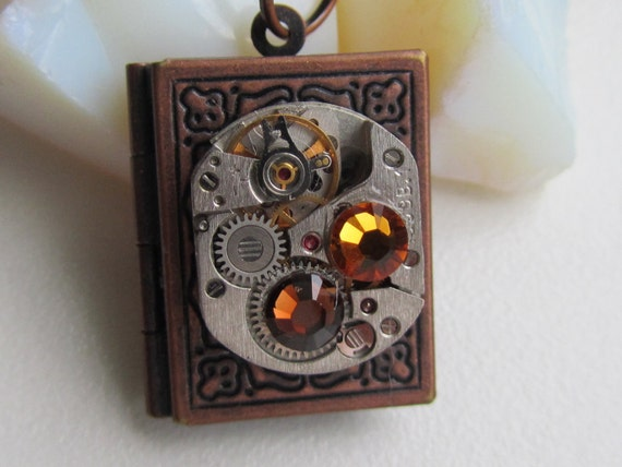 Steampunk Jewelry, Steampunk book locket necklace with vintage watch  movement and real Swarovski crystals