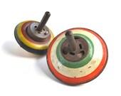 2 vintage tin litho tops offered by Elizabeth Rosen