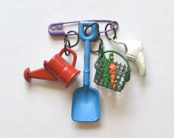 vintage enamel charms metal watering can shovel basket gardening shoe vintage brooch pin   offered by Elizabeth Rosen