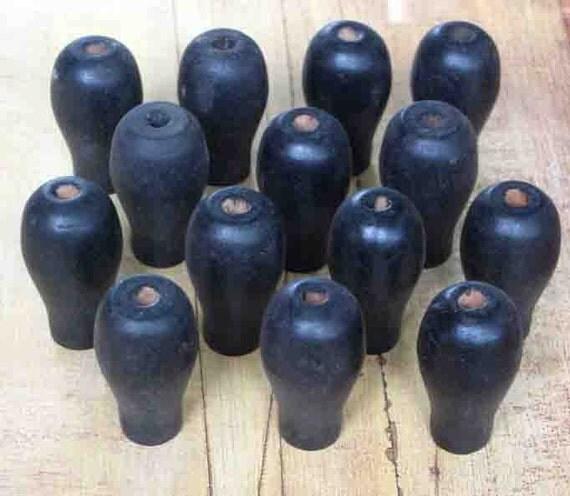 10 vintage black toy part knobs or handles from Elizabeth Rosen