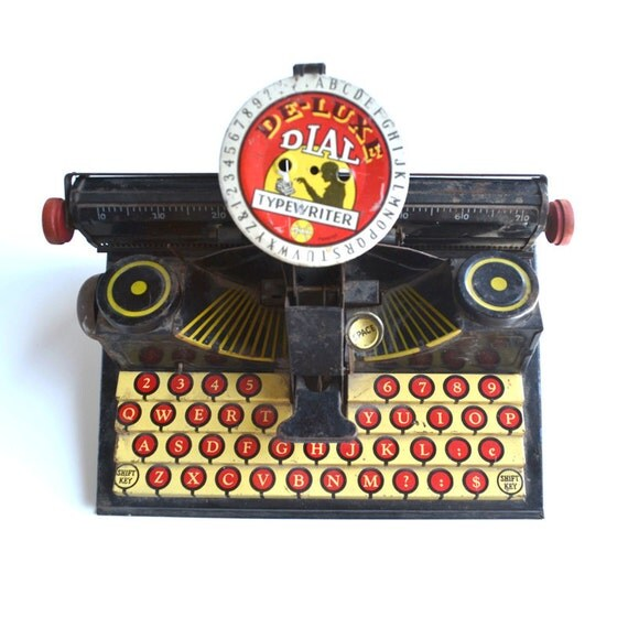 Vintage toy vintage tin litho Marx De-Luxe Dial Typewriter Great Graphics  offered by Elizabeth Rosen