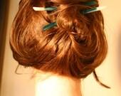 Transparent emerald green resin hair sticks.