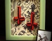 Lucy Furr Earrings. Red wooden upside-down cross earrings.