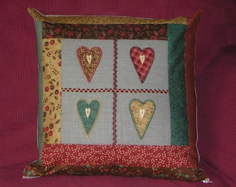 Primitive hearts, warm colours, applique patchwork cushion, pillow. Embroidered linen. Ready to ship.
