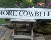 Classic, one-of-a-kind hand painted MORE COWBELL sign