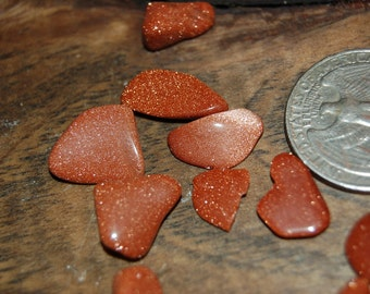 Goldstone, sparkles like gold and is priceless too in 2 sizes