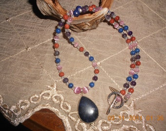 Lapis Lazuli Pendant, Sunstone, Amethyst, Cat eye, and Swarvski crystals 20% off