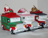 RARE SET of 7 / Department 56 / Village Express Vans......one for every holiday. FRee SHIPPING.