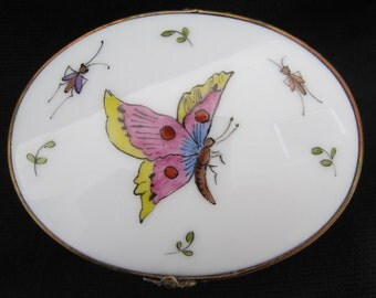 Limoges porcelain collectors box with Butterflies and bugs hand painted onto it.