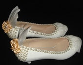 White fur feather and pearl decorated shoes for wedding or party