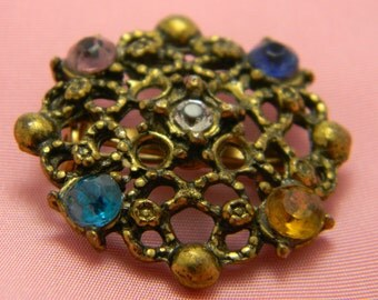 Ornate gold patina vintage brooch multi color rhinestones
