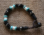Bracelet made from a selection of bead stones: coconut, bone, turquoise, shark bone.