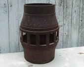 architectural salvage rusty primitive cast iron wagon wheel hub