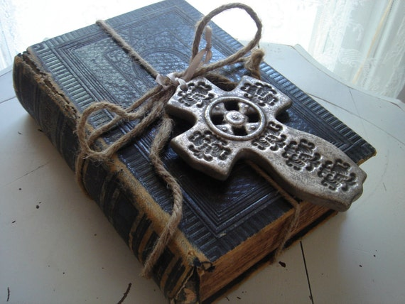 upcycled 1892 leather bound German bible jute bundled with antique silver painted clay cross ornament