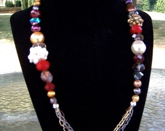 Jewels, clusters of pearls, and chains.