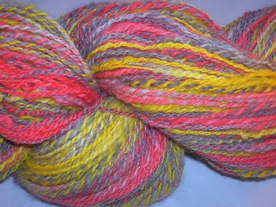 Handspun, hand dyed, soft merino fingerring 2-ply yarn.