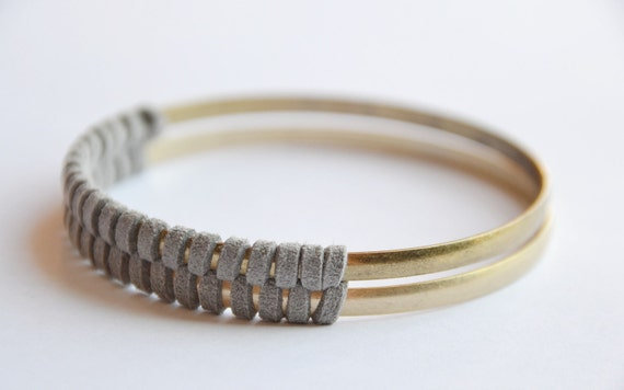 Gold and suede bangle set. Gray suede, herringbone pattern. One matte gold, one bright gold woven together. Stunning design in person.