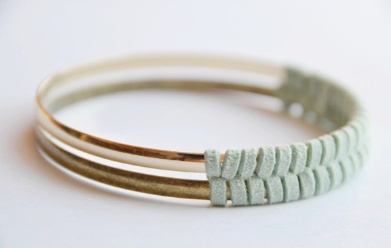 Gold and suede bangle set. Mint suede, herringbone pattern. One matte gold, one bright gold woven together. Stunning design, heavier weight.