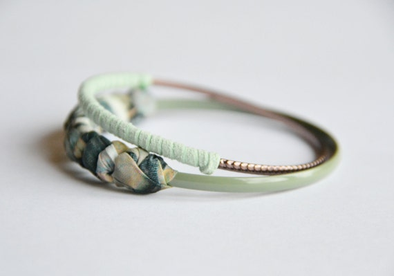 Fabric and suede bangles. set of 2. Hand wrapped dark pastel fabric and mint suede. One bronze bangle, one sage green. Small size.