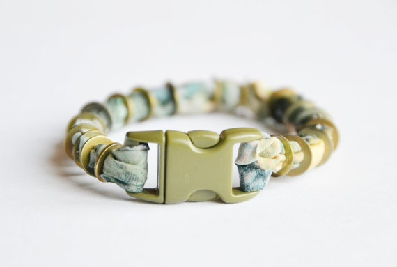SALE. Fabric and metal cuff.  Pastel fabric with vintage nuts and bolts and snap buckle closure.  Small size. 25% OFF.