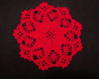 """Red crocheted 6"""" accent doily"""