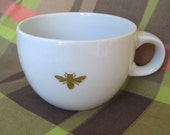 reCYCLEd cup with honeybee