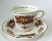 Vintage reCYCLEd cup and saucer with gold honey bee