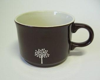 reCYCLEd mug with leafy tree