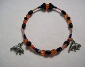 Reduced 10 per cent Orange, Blue & Black Memorywire Charm Bracelet